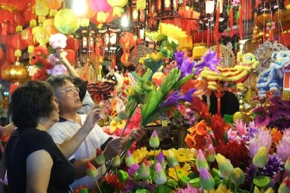 Customers select some plastic flowers for Chinese New Year at Chinatown, Singapore