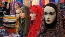 Hijabs are seen draped over models