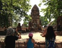 Visitors take picture at ancient Ayutthaya ruins, outside of Bangkok